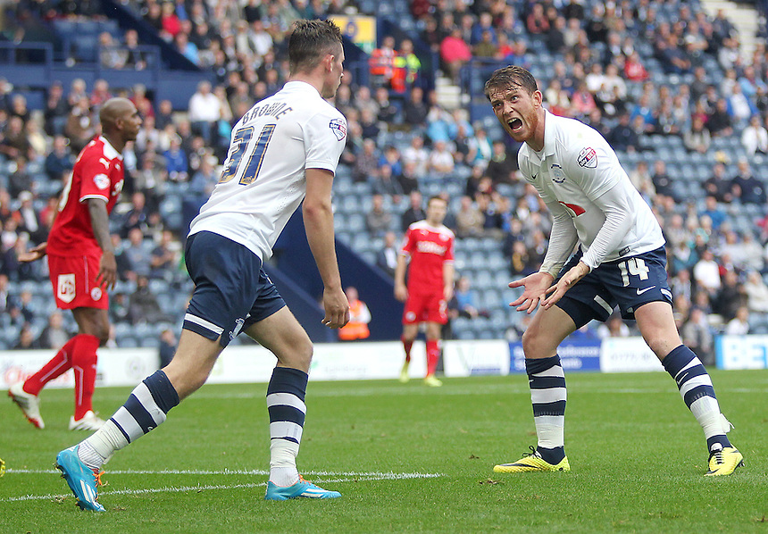 Preston North End's Joe Garner remonstrates to team-mate Alan Browne after an attacking manoeuvre falls flat<br /> <br /> Photographer Rich Linley/CameraSport<br /> <br /> Football - The Football League Sky Bet League One - Preston North End v Crawley Town - Saturday 20th September 2014 - Deepdale - Preston<br /> <br /> &copy; CameraSport - 43 Linden Ave. Countesthorpe. Leicester. England. LE8 5PG - Tel: +44 (0) 116 277 4147 - admin@camerasport.com - www.camerasport.com