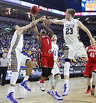 SIOUX FALLS, SD - MARCH 9: Trey Norris #1 of USD attempts a shot under heavy defense by SDSU in the first half of their semi-final round Summit League Championship Tournament game Monday evening at the Denny Sanford Premier Center in Sioux Falls, SD. (Photo by Dick Carlson/Inertia)