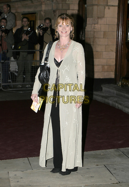 SAMANTHA BOND.Woman In White Royal Gala Performance, Palace Theatre.September 13th, 2004.full length, long sheer embroidered tie up sweater, black bag.www.capitalpictures.com.sales@capitalpictures.com.© Capital Pictures.