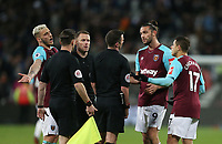 West Ham United's Marko Arnautovic, Andy Carroll and Javier Hernandez argue with referee Michael Oliver at the end of the game<br /> <br /> Photographer Rob Newell/CameraSport<br /> <br /> The Premier League - West Ham United v Stoke City - Monday 16th April 2018 - London Stadium - London<br /> <br /> World Copyright &copy; 2018 CameraSport. All rights reserved. 43 Linden Ave. Countesthorpe. Leicester. England. LE8 5PG - Tel: +44 (0) 116 277 4147 - admin@camerasport.com - www.camerasport.com