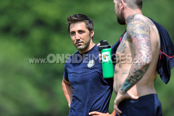 Gavin Henson looks on from the sidelines. Bath Rugby pre-season training session on July 16, 2013 at Farleigh House in Bath, England. Photo by: Patrick Khachfe/Onside Images