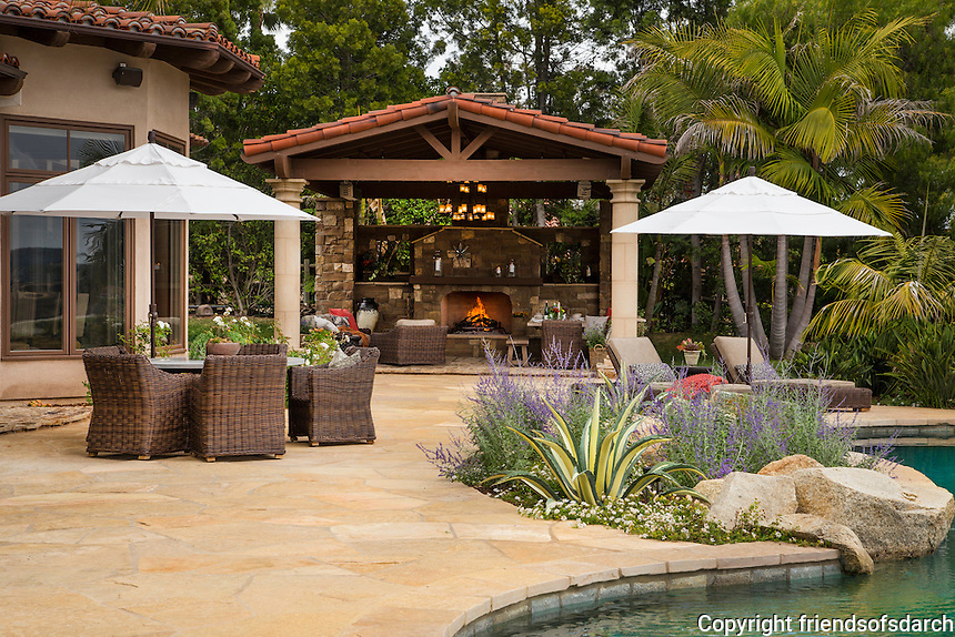Gustafson Residence, Rancho Santa Fe, CA. Covered patio, fireplace, barbecue, pool deck. Landscape design by Kelly Fore Dixon. Photographer: David Verdugo.