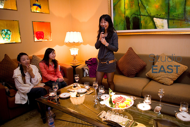 LIU li 'Helene' (standing) sings in a karaoke with friends, in Shanghai, China, on October 22, 2010. Photo by Lucas Schifres/Pictobank