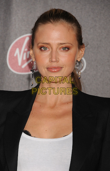 "Estella Warren.World Premiere of ""Immortals 3D"" at Nokia Theatre L.A. Live in Los Angeles, California, USA..November 7th, 2011.headshot portrait black earrings white.CAP/ROT/TM.© TM/Roth/Capital Pictures"