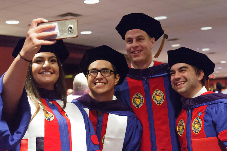 Students commemorate their graduation by taking selfies with family and friends after the DePaul University College of Law commencement ceremony, Sunday, May 14, 2017, at the Rosemont Theatre in Rosemont, IL, where some 240 students received their Juris Doctors or Master of Laws degrees. (DePaul University/Arielle Toub)