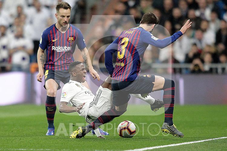 Real Madrid CF's  Vinicius Junior and FC Barcelona's Ivan Rakitic and Gerard Pique (L) during La Liga match. March 02,2019. (ALTERPHOTOS/Alconada)
