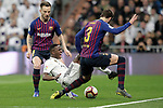 Real Madrid CF's  Vinicius Junior and FC Barcelona's Ivan Rakitic and Gerard Pique (L) during La Liga match. March 02,2019. (ALTERPHOTOS/Alconada)
