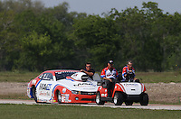 Apr. 26, 2013; Baytown, TX, USA: Crew members tow the car of NHRA pro stock driver Greg Stanfield during qualifying for the Spring Nationals at Royal Purple Raceway. Mandatory Credit: Mark J. Rebilas-