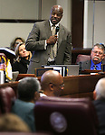 Nevada Sen. Kelvin Atkinson, D-North Las Vegas, honors former Sen. Bernice Mathews, lower left, during a ceremony inducting her into the Nevada Senate Hall of Fame at the Legislative Building in Carson City, Nev., on Wednesday, April 17, 2013. .Photo by Cathleen Allison