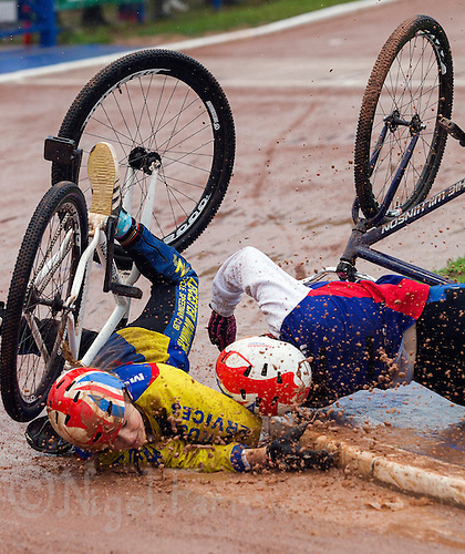 31 AUG 2015 - IPSWICH, GBR - Lizzie Rigley (left) of Leicester Monarchs and Lily Gedge (right) of Ipswich are thrown from their bikes after a collision during the run-off for the under 16 women's title at the British Cycle Speedway Championships at Whitton Sports and Community Centre in Ipswich, Suffolk, Great Britain.  2014 champion Gedge went on to retain her title in the rerun (PHOTO COPYRIGHT © 2015 NIGEL FARROW, ALL RIGHTS RESERVED)