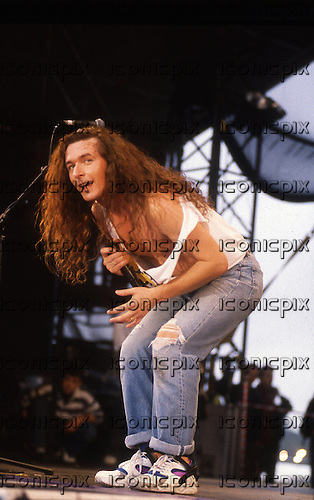 Thunder - vocalist Danny Bowes - performing live at the Monsters of Rock festival at Castle Donington Leicestershire UK - 22 Aug 1992.  Photo credit: George Chin/IconicPix