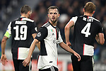 Miralem Pjanic of Juventus with Leonardo Bonucci and Matthijs De Ligt in the background during the UEFA Champions League match at Juventus Stadium, Turin. Picture date: 26th November 2019. Picture credit should read: Jonathan Moscrop/Sportimage