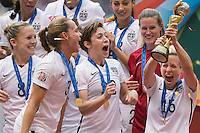 United States Amy Rodriguez, Christie Rampone, Meghan Klingenberg and Megan Rapinoe celebrate 5-2 victory over Japan in the Women's World Cup final match, Sunday July 05, 2015 in Vancouver, British Columbia.