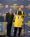 16 January 2004: Chad Marshall (right) of Stanford University, with MLS Commissioner Don Garber (left), was selected with the second pick of the draft by the Columbus Crew. The Major League Soccer SuperDraft was held at the Charlotte Convention Center in Charlotte, NC as part of the annual National Soccer Coaches Association of America convention...