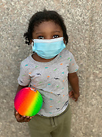 5/3/20-New York, New York City in the time of Coronavirus. This little guy has been living sheltered in place and now out with his mother and aunt, is anxious to get to the park on this gorgeous spring day.