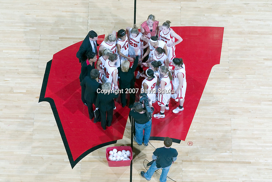 MADISON, WI - JANUARY 28: The Wisconsin Badgers huddle after the game against the Minnesota Golden Gophers at the Kohl Center on January 28, 2007 in Madison, Wisconsin. The Badgers beat the Golden Gophers 70-57. (Photo by David Stluka)
