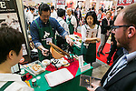 Exhibitors offer samples of their products to visitors at the Hokkaido booth during the 41st International Food and Beverage Exhibition (FOODEX JAPAN 2016) on March 8, 2016, Chiba, Japan. 3,000 exhibitors from 78 nations are showcasing their products in Asia's largest food and beverage trade show held at Makuhari Messe. This year organisers expect 75,000 visitors during the four day show from March 8 to 11. (Photo by Rodrigo Reyes Marin/AFLO)