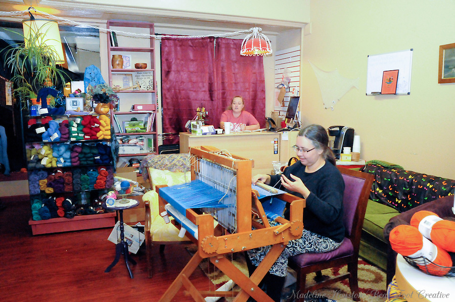 Jen demonstrates weaving while Teva Youngblood looks on at Loose Ends Fiber Arts during Centralia, Washington's Third Thursday on October 20, 2016.