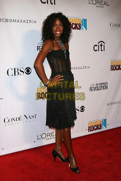 KELLY ROWLAND (DESTINY'S CHILD).Arrivals at Fashion Rocks held at Radio City Music Hall,.New York, 8th September 2005.full length black dress corset top hand hip.Ref: IW.www.capitalpictures.com.sales@capitalpictures.com.©Capital Pictures