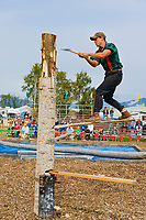 Lumberjack compete in log chopping contest at the Alaska State Fair, Palmer, Alaska.
