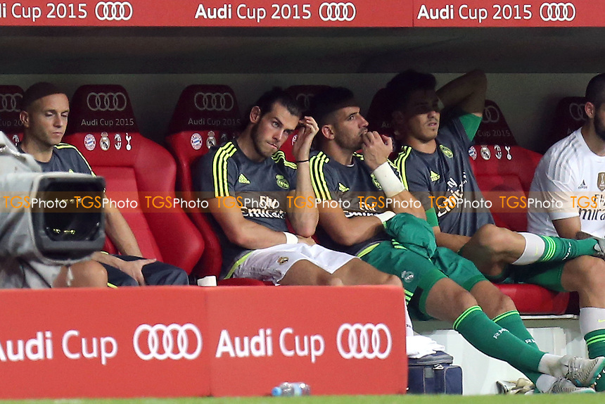 Gareth Bale of Real Madrid looks on from the subs bench
