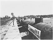 Special oil train at D&amp;RGW loading facility in Farmington.  Car banner reads &quot;This Shipment from Farmington, NM Oil Fields&quot;<br /> D&amp;RGW  Farmington, NM  1925