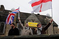 English Defence League (EDL) demonstration<br /> called in protest to the proposed building of a new mosque in Dudley.<br /> <br /> Members of the Dudley Central Mosque waving British and English flags.