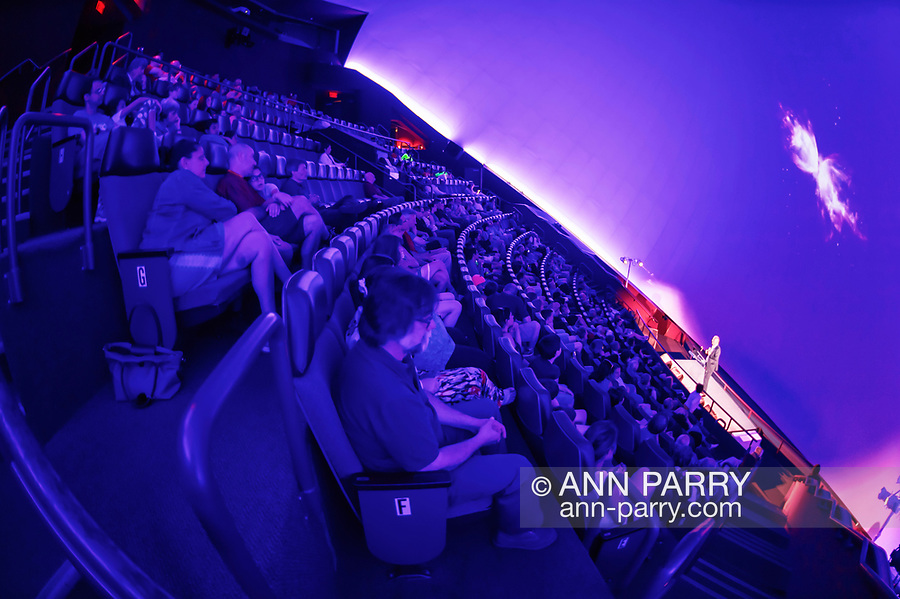 Garden City, New York, USA. June 21, 2018. NASA space shuttle astronaut MIKE MASSIMINO, a Long Island native, is on stage giving free lecture to audience in the JetBlue Sky Theater Planetarium at the Cradle of Aviation Museum.