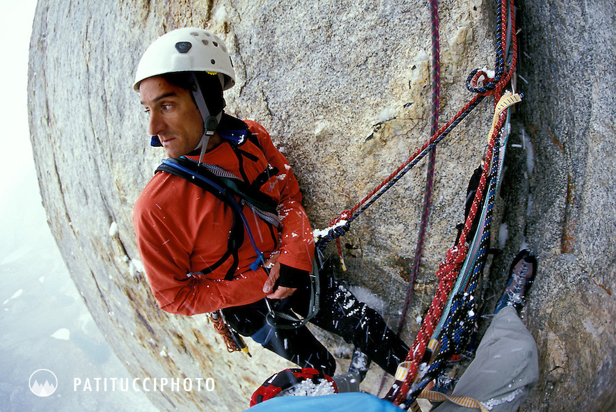 Dan Patitucci hanging at a belay on Mt. Russell's Mithral Dihedral, looking scared and uncomfortable as it begins to snow