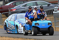 Aug. 3, 2013; Kent, WA, USA: NHRA funny car driver Matt Hartford with crew during qualifying for the Northwest Nationals at Pacific Raceways. Mandatory Credit: Mark J. Rebilas-USA TODAY Sports