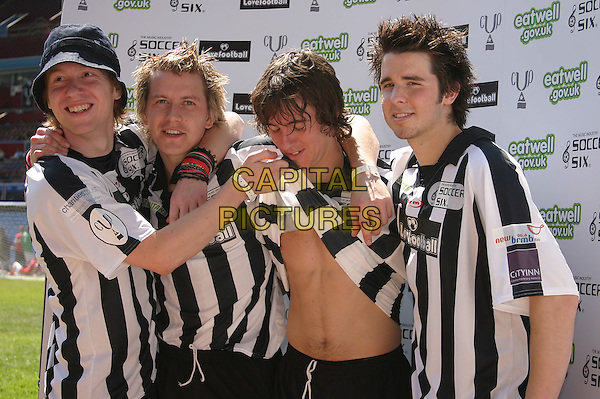 FREEFALLER - OLLIE, DEAN, GARY & RICH.10th Annual Music Inductry Soccer Six Tournament, Aston Villa Football Ground, Birmingham..May 15th, 2005.half length uniforms chest lifting shirt.www.capitalpictures.com.sales@capitalpictures.com.©Capital Pictures