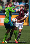 Seattle Sounders' Dylan Remick, left, battles for the ball with Colorado Rapids' Nathan Sturgis during an MLS match on April 26, 2014 in Seattle, Washington.  The Seattle Sounders beat the Colorado Rapids 4-1.  Jim Bryant Photo. ©2014. All Rights Reserved.