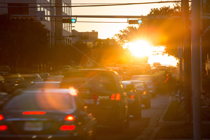 "The sun rises over downtown Austin traffic jam as state workers and commuters drive to the Capitol of Texas. ""Greetings from Austin the Traffic Congestion Capitol of Texas."""