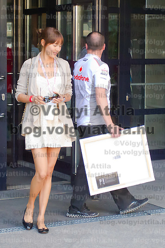 Japanese-Argentine model Jessica Michibata, girlfriend of McLaren Formula One driver Jenson Button of Britain attends the Vodafone Downtown Grand Prix in Budapest, Hungary on May 01, 2012. ATTILA VOLGYI