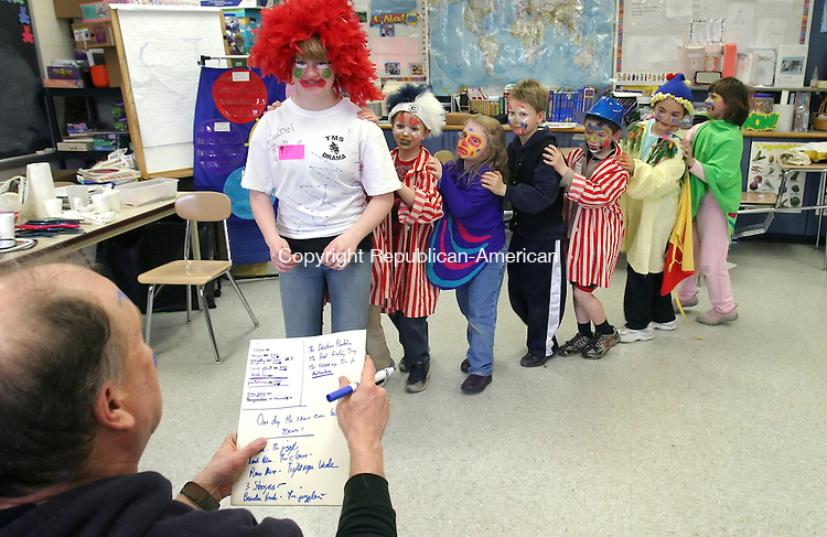 TORRINGTON, CT-04 APRIL 2009 --040409JS02--Volunteer Tony Wilusz of Torrington, left, directs a &quot;circus train&quot; led my Torrington Middle School student Abby Whalen leads children sround the room during the &quot;Clown Around&quot;   program Saturday at the Torrington Middle School. The program was just one of many programs offered during the Minds in Motion program sponsored by the Connecticut Associatioin for the Gifter and Friends of Torrington Education. <br /> Jim Shannon Republican-American