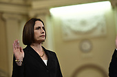 Dr. Fiona Hill, former Senior Director for Europe and Russia, National Security Council (NSC), and David A. Holmes, Political Counselor, United States Embassy in Kyiv, Ukraine, on behalf of US Department of State, is sworn-in to testify during the US House Permanent Select Committee on Intelligence public hearing as they investigate the impeachment of US President Donald J. Trump on Capitol Hill in Washington, DC on Thursday, November 21, 2019.<br /> Credit: Ron Sachs / CNP<br /> (RESTRICTION: NO New York or New Jersey Newspapers or newspapers within a 75 mile radius of New York City)