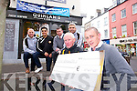 l-r Daragh Long, Austin Stacks, Wayne Guthrie, Austin Stacks, Dan Foley, Austin Stacks, Stephen Stack, Austin Stacks, front l-r Timmy Sheehan, Austin Stacks and Fintan Quinlan of Quinlans Fish presenting a sponsorship cheque for the Rockies Night at the Dogs at the Kingdom Greyhound Stadium on Friday the 23rd of May