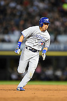Toronto Blue Jays second baseman Munenori Kawasaki (66) running the bases during a game against the Chicago White Sox on August 15, 2014 at U.S. Cellular Field in Chicago, Illinois.  Chicago defeated Toronto 11-5.  (Mike Janes/Four Seam Images)