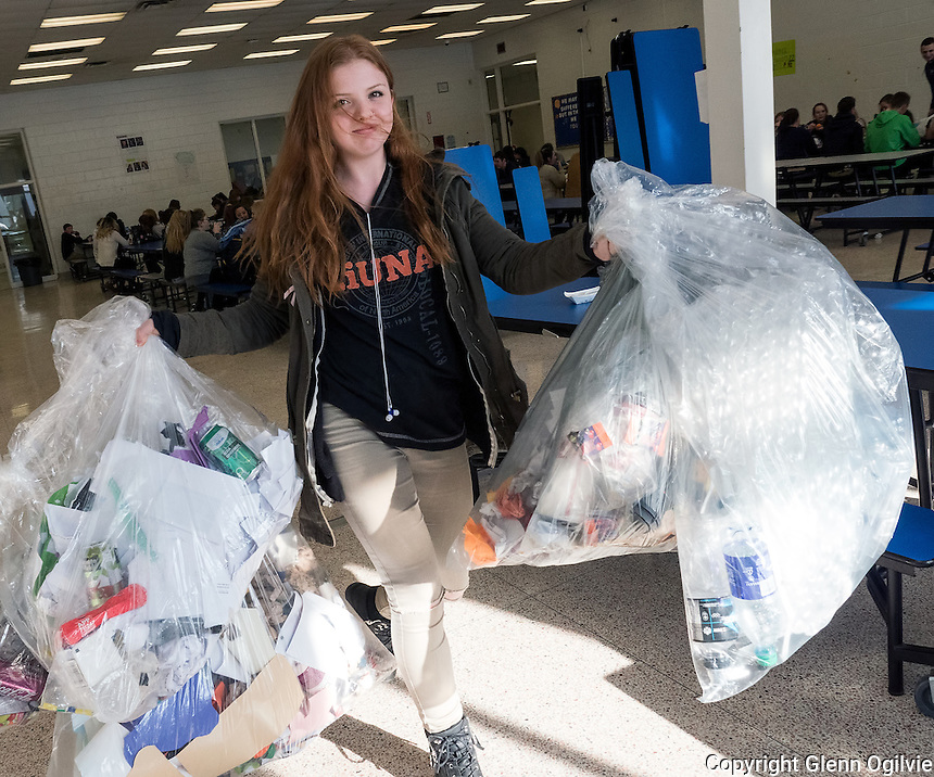 A total of 366 pounds in 71 large plastic bags  garbage and recyclables was collected in one day at Great Lakes Secondary School by custodial staff. The small mountain of waste was turned over to the 10 member GLSS student Stewardship Squad to help shine light on the waste management practices at the school. Grace Van Ered, Emily Cyr, Sophia Chateauneuf, blue hair and Carrie Champagne