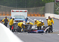 May 5, 2017; Commerce, GA, USA; NHRA safety safari rescue crews tend to super comp driver Jimmy Stahl after crashing during qualifying for the Southern Nationals at Atlanta Dragway. Stahl was alert and transported to a local hospital for observation. Mandatory Credit: Mark J. Rebilas-USA TODAY Sports