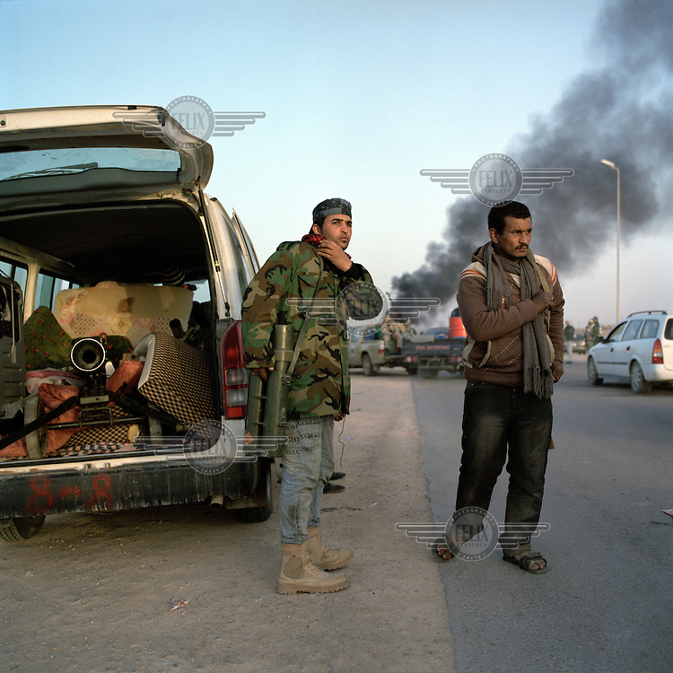 Rebel fighters look on anxiously after being pushed back to the town of Ben Jawad by heavy shelling and rocket fire from Gaddafi forces. Earlier that day the rebels had advanced, unchallanged to within 80km of the Gaddafi stronghold of Sirt. On 17 February 2011 Libya saw the beginnings of a revolution against the 41 year regime of Col Muammar Gaddafi.