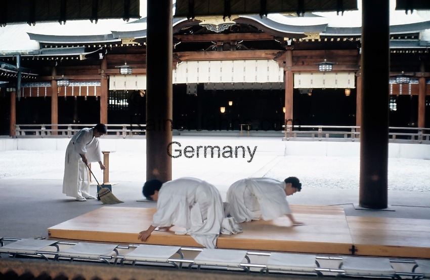 Japan, Tokyo: Meiji-Shrine at Shibuya district, novices cleaning, sweeping the ground