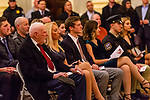 WATERBURY, CT. 20 December 2019-122019BS243 - From left, Terry Ballou's father Joe Ballou and Terry's wife Jennifer, along with the rest of the Ballou family look on, during the Fire Chief swearing in ceremonies at City Hall on Friday. Terry Ballou replaces former Fire Chief David Martin, who retired earlier this year. Bill Shettle Republican-American