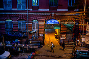 A pedestrian walks past a government office housed in a colonial-era building in the BBD Bagh area of Kolkata, India, on Thursday, May 25, 2017. Photographer: Sanjit Das