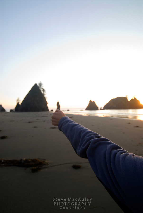 """""""Thumbs up"""" play with sea stacks silhouette and hand at sunset, Shi Shi Beach, Olymipic National Park Coastal Strip"""