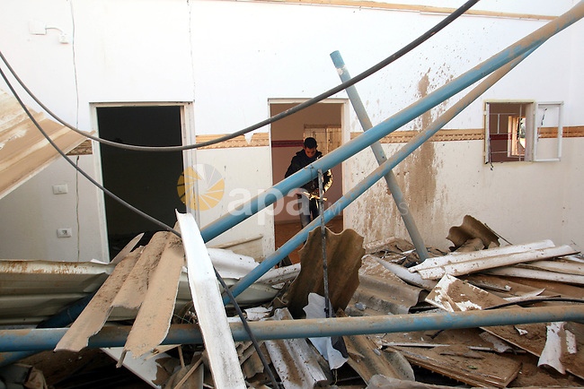 A Palestinian man inspects the damage in his house hit by a missile fired by Israeli air forces in the southern of Gaza strip town of Rafah, November 15, 2012. Several Palestinians were killed following a series of Israel's concurrent airstrikes on Gaza city, among them was Ahmed al-Jaabari, top commander of Hamas armed wing Al-Qassam brigades, and more than 150 others wounded, government's emergency services in the Gaza Strip said. Photo by Eyad Al Baba