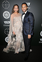 06 January 2018 - Santa Monica, California - Chrissy Teigen, John Legend. The Art Of Elysium's 11th Annual Black Tie Artistic Experience HEAVEN Gala held at Barker Hangar. <br /> CAP/ADM/FS<br /> &copy;FS/ADM/Capital Pictures