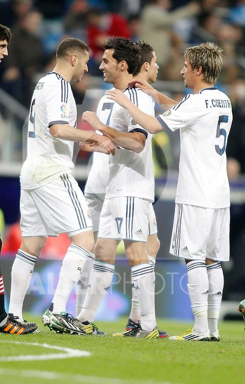 Real Madrid's Karim Benzema celebrates with Alvaro Arbeloa and Michael Essien during La Liga Match. November 17, 2012. (ALTERPHOTOS/Alvaro Hernandez)