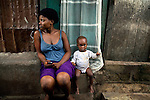 Aminata Mansaray, sits next to her baby brother Abu Mansaray on their front porch in Mabella quarter, Freetown, Sierra Leone, Aug. 13, 2012. Médecins Sans Frontières Belgium, in collaboration with the Sierra Leone Ministry of Health, is running four emergency cholera treatment centers to keep up with the number of patients. Many of the roughly 120 daily patients seen by the MSF team come from extremely impoverished areas of the densely-populated capital, where proper systems for drainage and waste disposal are almost non-existent. Outbreaks of water-borne diseases like cholera become even more likely during the rainy season, which is expected to last at least two more months.