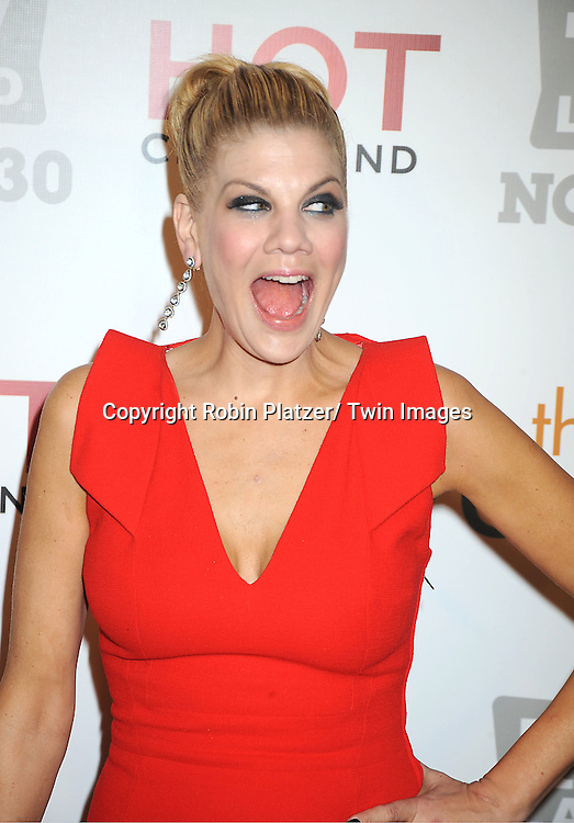 "Kristen Johnston in Antonio Teradi red dress attends the TV Land Party for the  premieres of ""Hot In Cleveland"" and ""The Exes""  on November 29, 2011 at SD26 in New York City. the party also celebrated Toys for Tots."